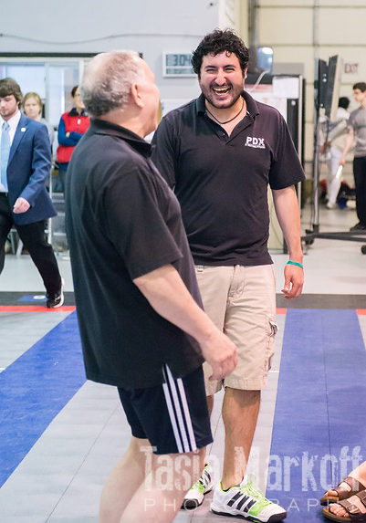 photo of coaches Charles and Hector laughing